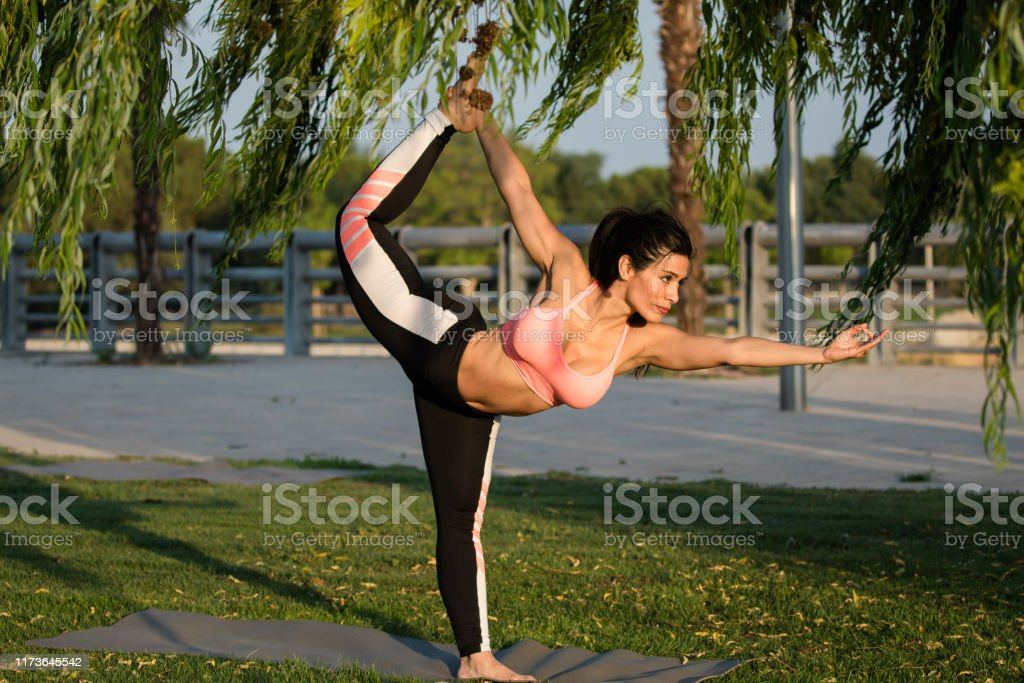 Latin Woman Does Yoga Exercises In A Park In Madrid Balance And Concentration Stock Photo Download Image Now Istock