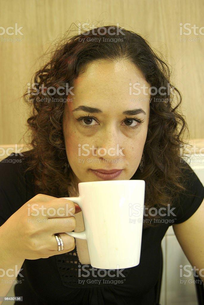 Latin woman having coffee in cafe, white mug royalty-free stock photo