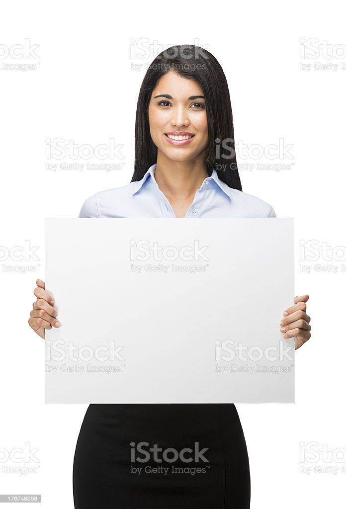 Latin woman holding a sign royalty-free stock photo