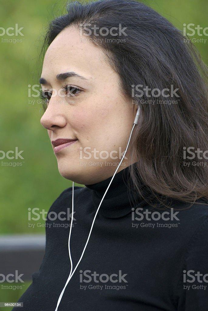 Latin woman listening to music royalty-free stock photo
