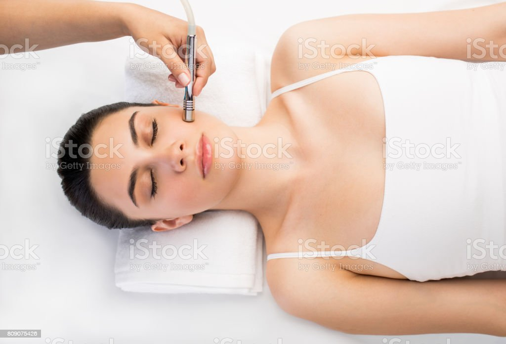 Latin woman relaxing and having a beauty treatment stock photo