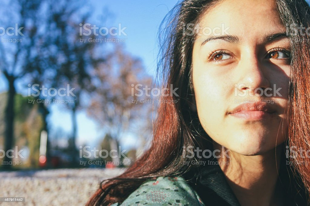 Latin woman sitting on a stairs in her university stock photo