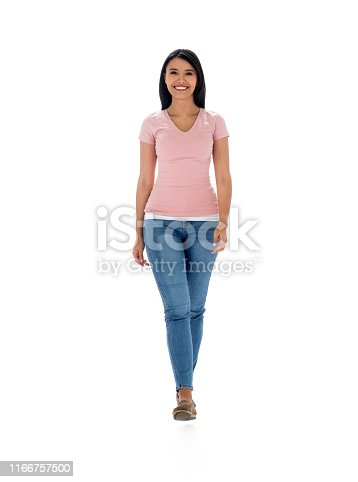 Latin woman walking towards the camera in the studio and smiling - isolated over a white background