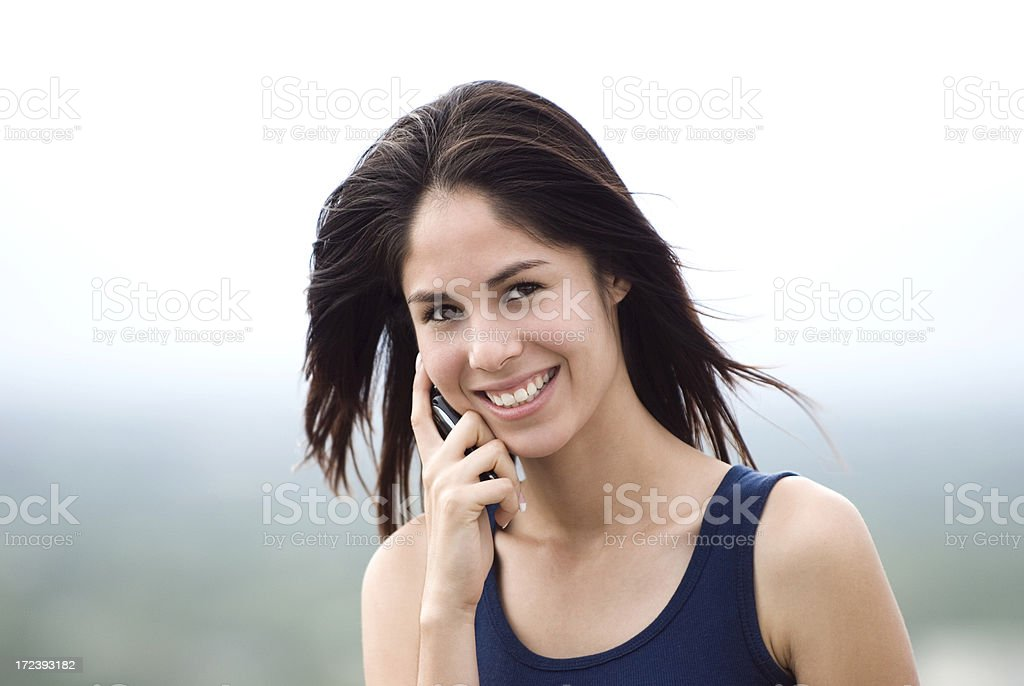 Latin woman with cellphone royalty-free stock photo