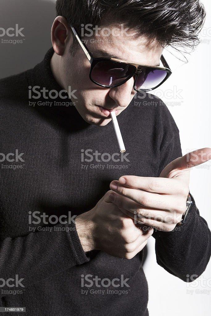 Latin young man smoking royalty-free stock photo