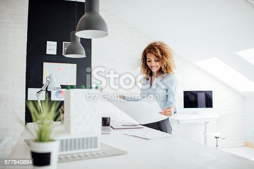 istock Latina Architect Working In Her Office. 577940894