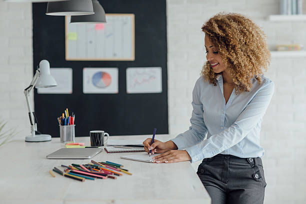 Latina Businesswoman Coloring Book In Her Office. stock photo