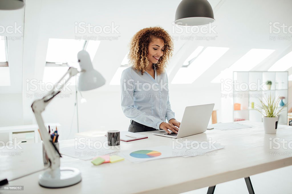 Latina Businesswoman Working In Her Office. stock photo
