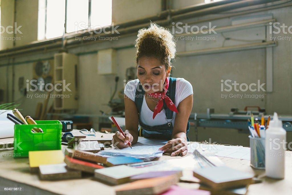 Latina Carpenter In Her Workshop stock photo