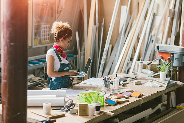 Latina Carpenter Standing In Her Workshop stock photo