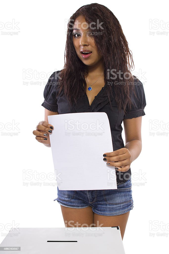 Latina Female Dropping an Envelope in a Voter Ballot Box royalty-free stock photo