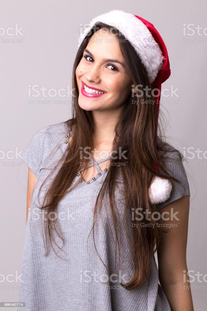 Latina girl in santa hat. Christmas theme stock photo