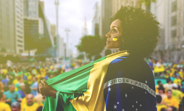 Latina woman holding Brazilian flag in Sao Paulo stock photo
