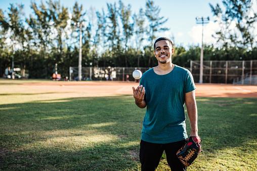Latino baseball player exercising pitching in USA