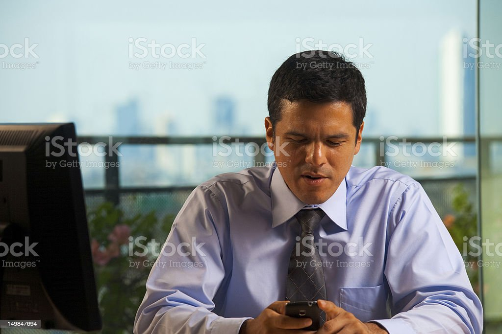 Latino Businessman Receives Bad News royalty-free stock photo