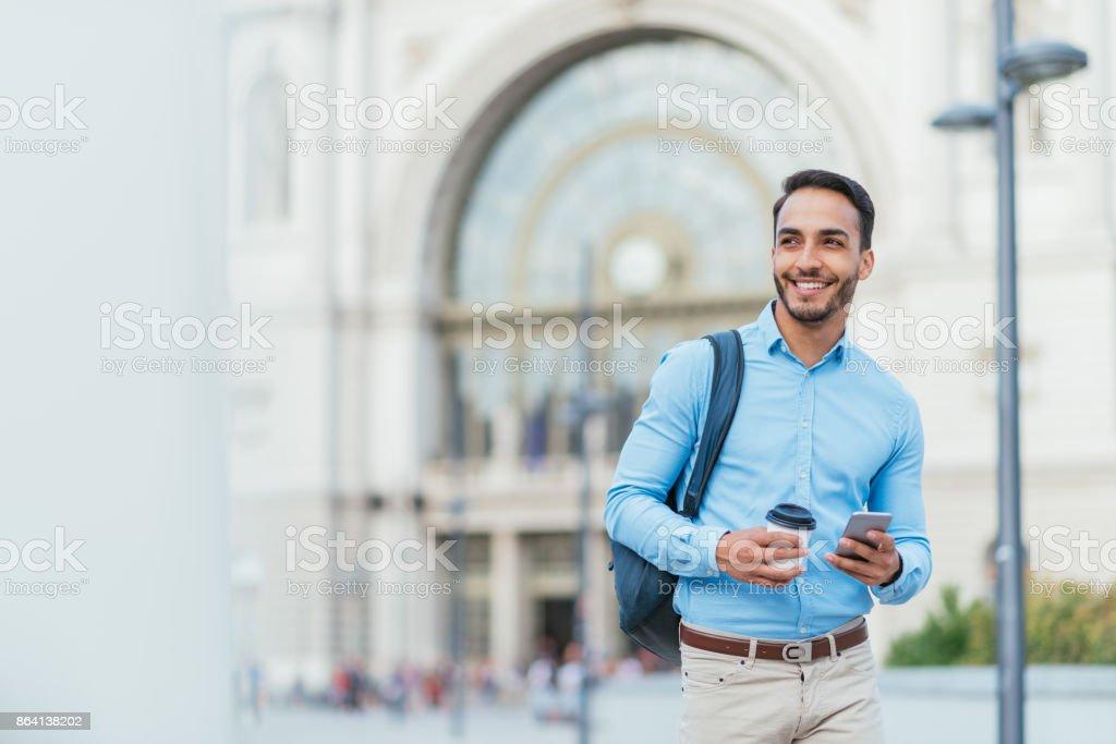 Latino businessman rushing to work royalty-free stock photo