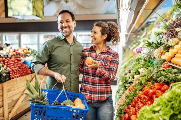 Latino couple buying vegan food stock photo