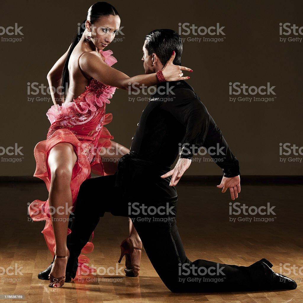 Latino dance couple dancing in ballroom stock photo