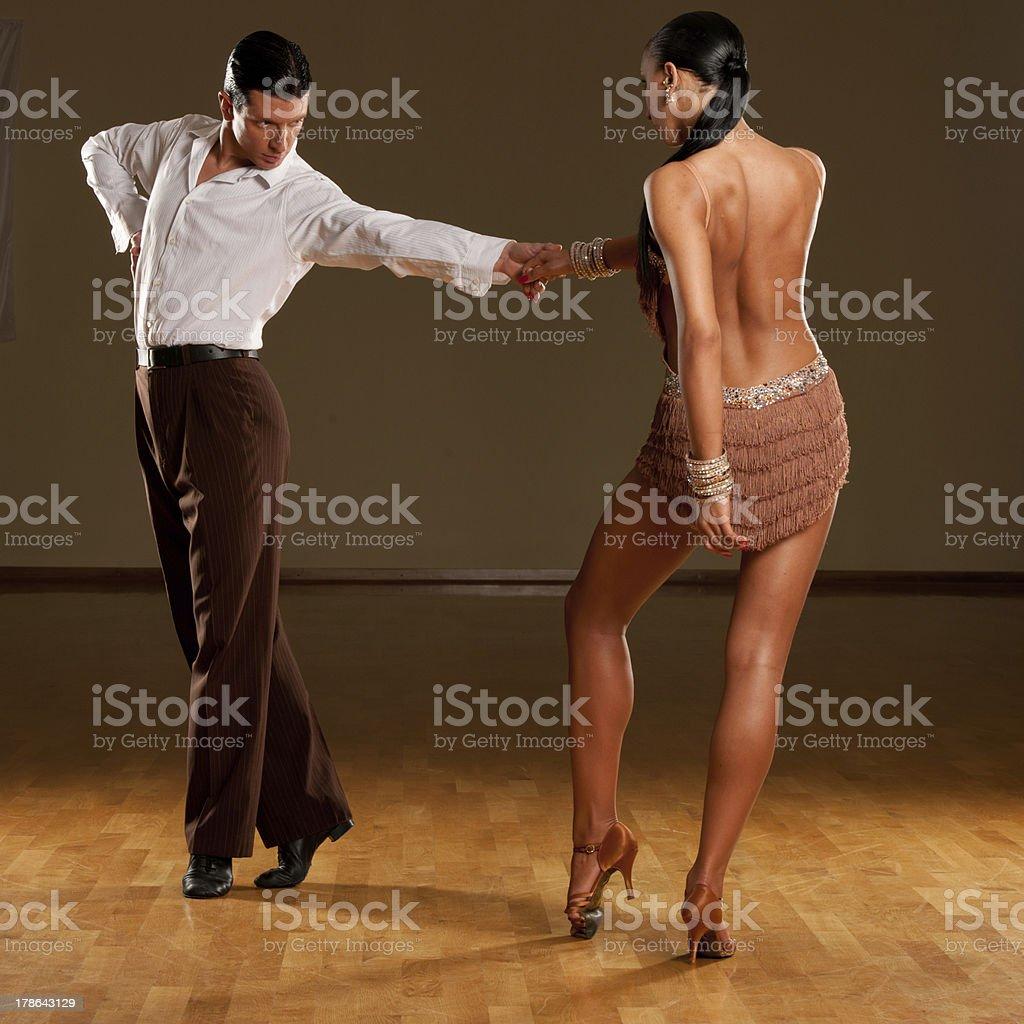 Latino dance couple dancing in ballroom royalty-free stock photo