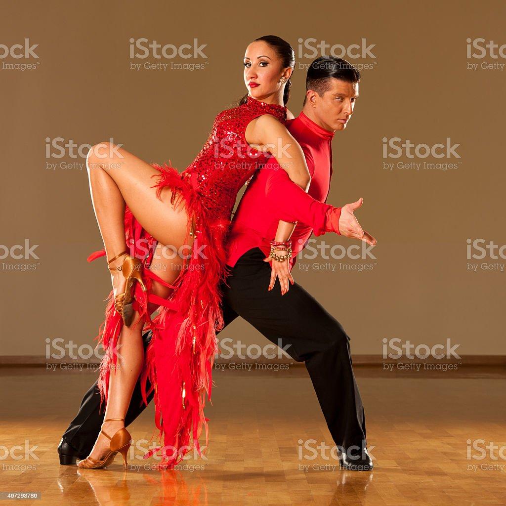 latino dance couple in action - dancing wild samba stock photo