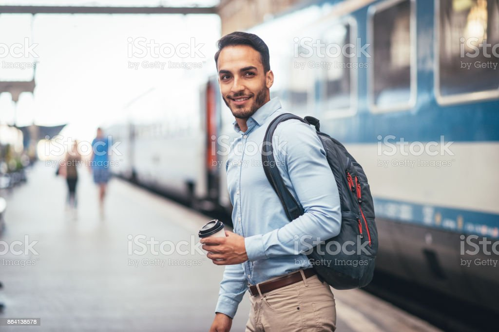 Latino man going to work by train royalty-free stock photo
