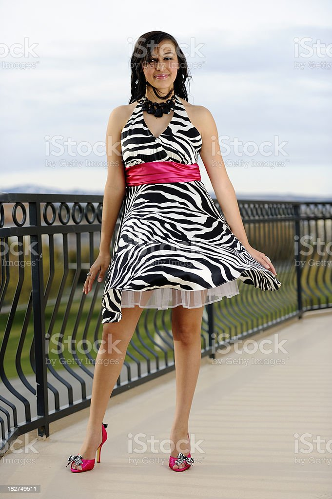 Latino Prom Girl Poised On Balcony In Early Morning Light royalty-free stock photo