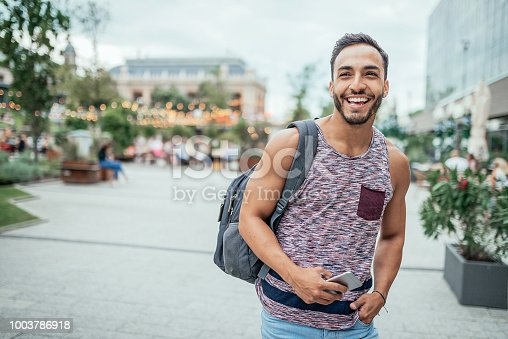 Portrait of 30 year old backpacker traveler from Latin America, discovering Central Europe in summer