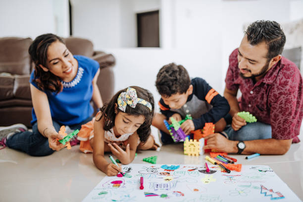 LatinoHispanic family at home, enjoying weekend with kids. stock photo