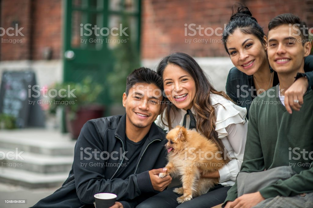 Latino/hispanic family photo of four beautiful people stock photo