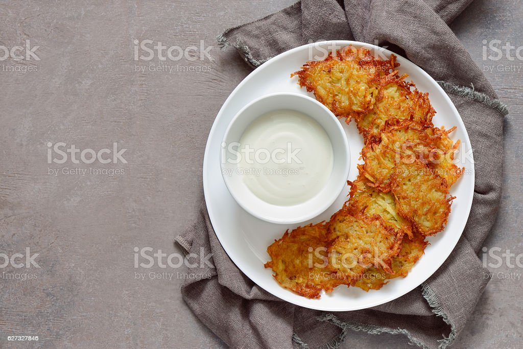Latkes with sour cream stock photo