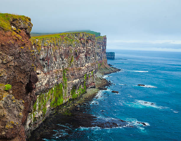 Latrabjarg Cape, Vestfirdir, Iceland, Edge of the world Beautiful vibrant view of the edge of the world, westernmost point in Europe, Iceland, Latrabjarg, looking like faroe islands, Moher Cliffs with atlantic puffins and other birds auk stock pictures, royalty-free photos & images