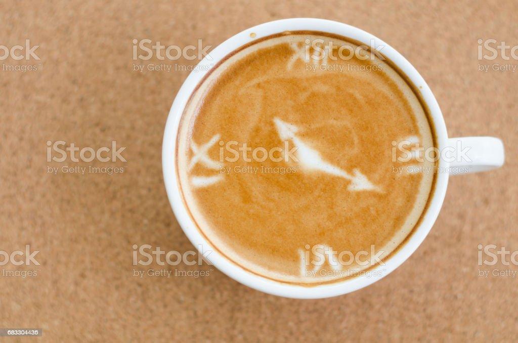 latte art coffee on brown wooden background royaltyfri bildbanksbilder