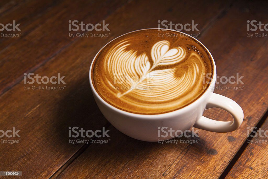 Latte art, coffee on the wooden desk as background. stock photo