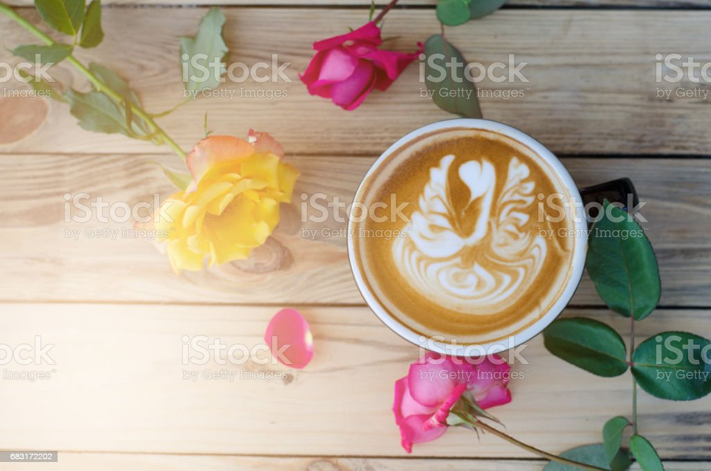 latte art coffee on wooden table royalty-free 스톡 사진