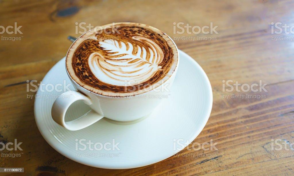 Latte art fern leave pattern of coffee on floor. stock photo