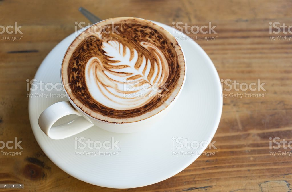 Latte art fern leave pattern of coffee (top view) stock photo
