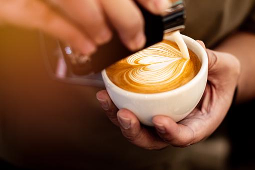 Barista making latte art.