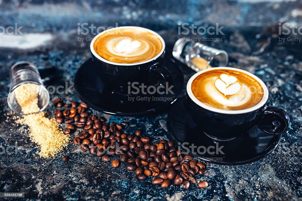 Latte art on espresso coffee. Black coffee served in bar stock photo