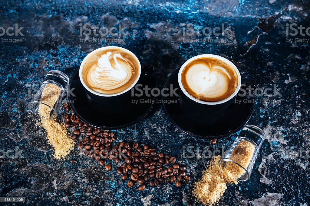 latte art on hot coffee and coffee beans stock photo