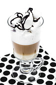 Latte, cappuccino with marshmallow on light background. Chocolate topping. Studio Photo