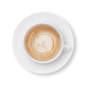 Top view of a latte coffee cup and saucer isolated on white - clipping path included (excluding the shadow)