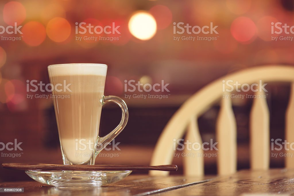 Latte coffee in tall glass,coffee shop background stock photo