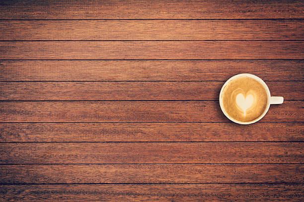 Latte coffee on table wood background with space - Photo