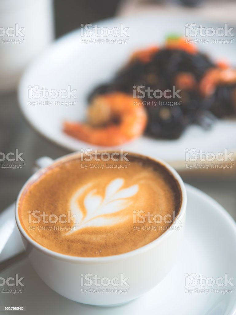 Latte coffee on the table in cafe - Foto stock royalty-free di Arte