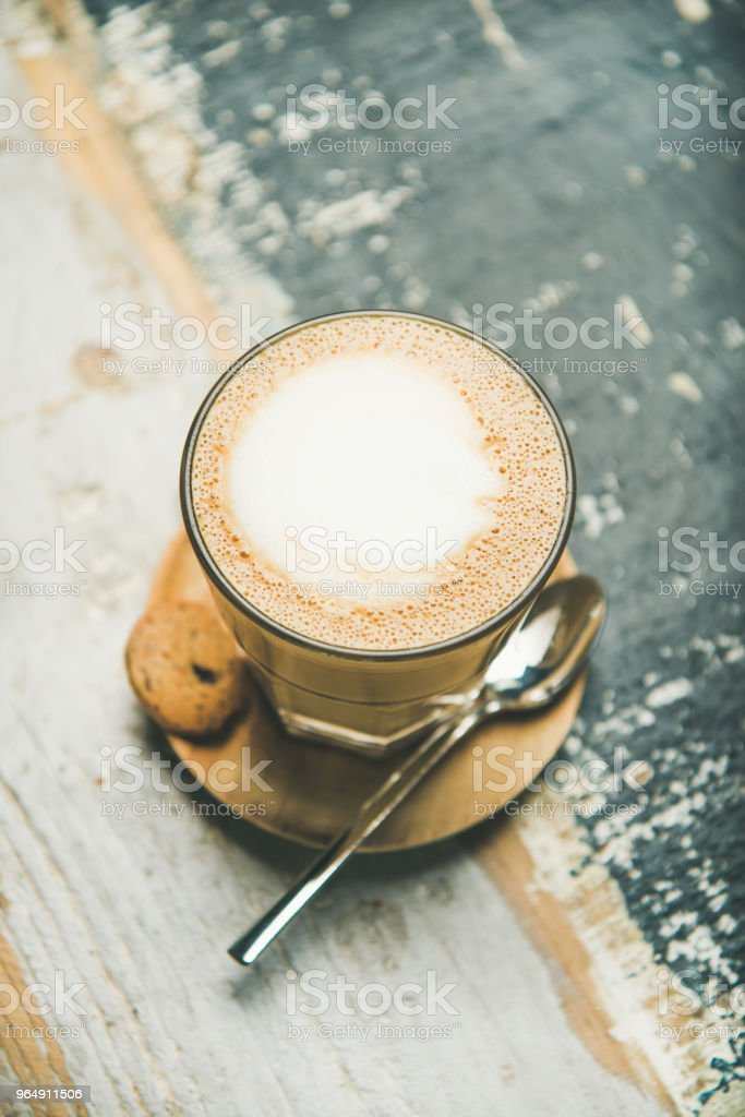 Latte coffee over rustic wooden painted background royalty-free stock photo