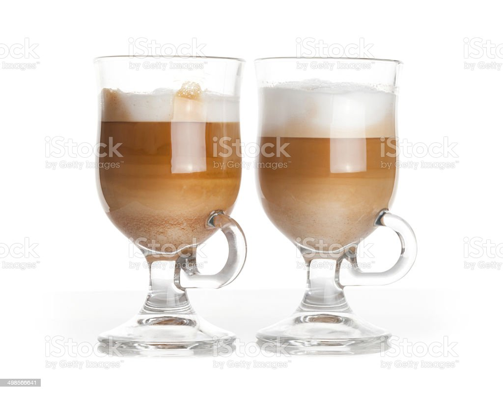 Latte coffee, two glass mugs with handles on white background stock photo