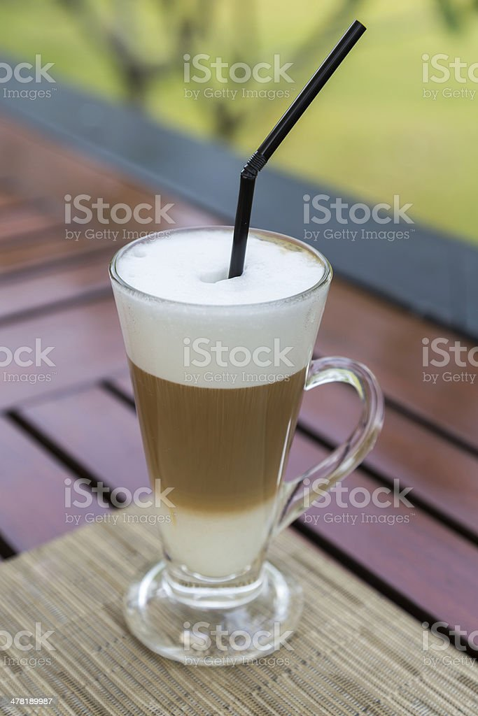 Latte macchiato in a glass with milk froth royalty-free stock photo