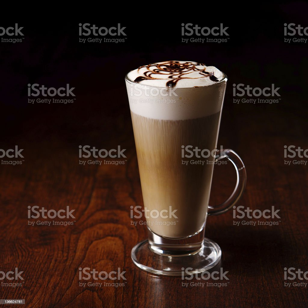 latte mug on a wooden table royalty-free stock photo