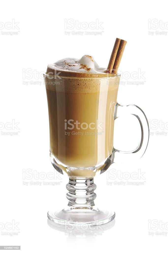 Latte with fresh cinnamon stick in glass mug  royalty-free stock photo