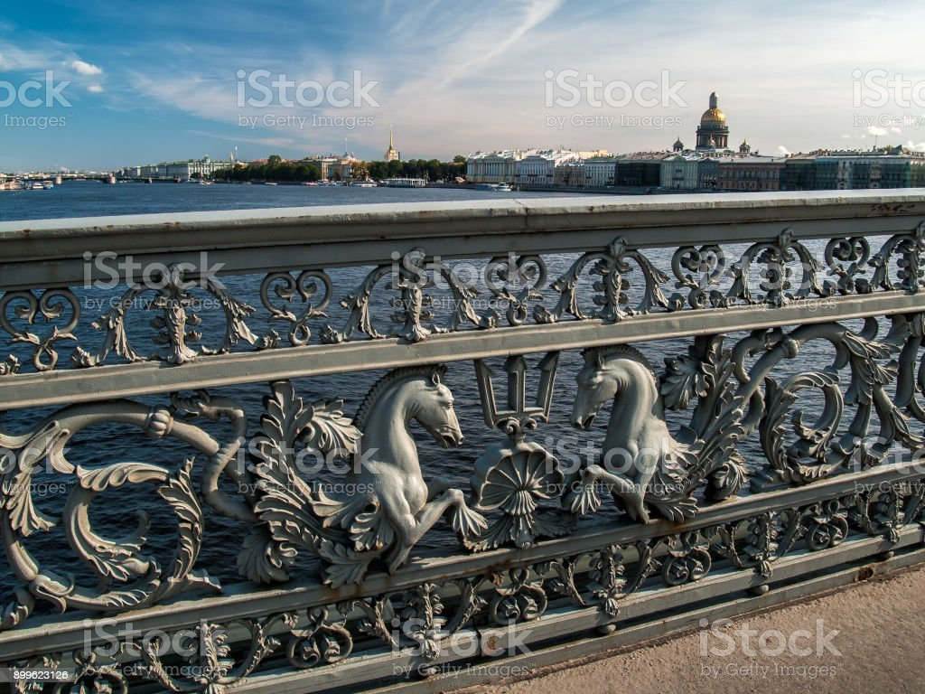 Lattice of the Annunciation Bridge with figures of horses against the background of St. Petersburg stock photo